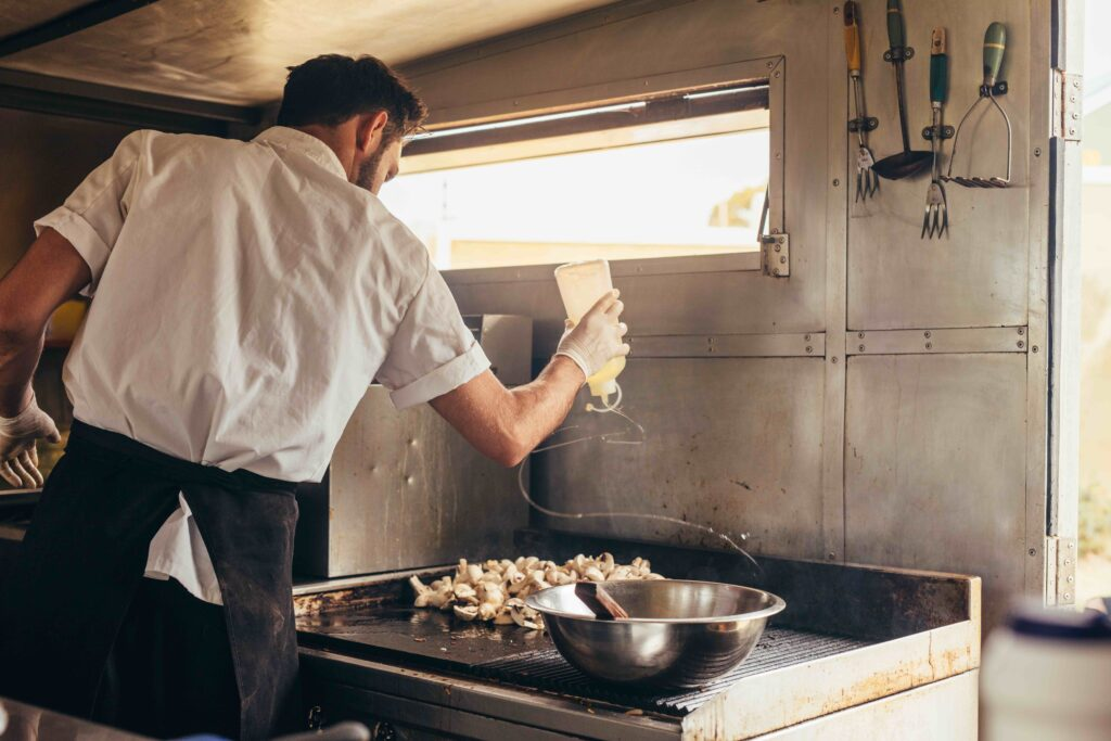 A chef preparing food in his food truck