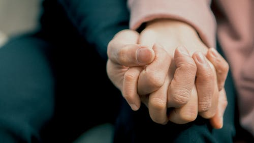 A picture of two people holding hands
