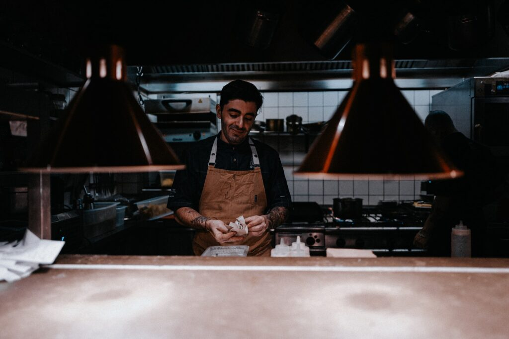 A chef in the kitchen preparing for service