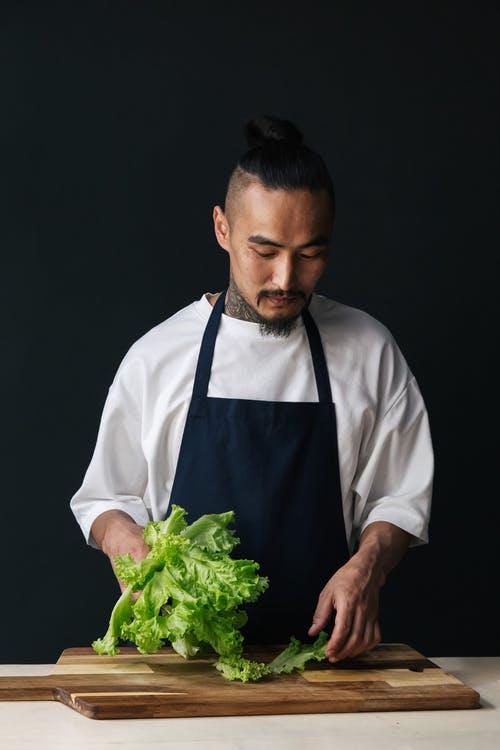 Chef prepping lettuce leaves
